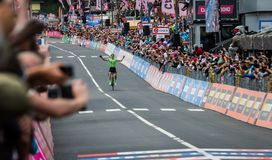 Canazei, Italy May 24, 2017: Pierre Rolland Cannondale-Drapac Pro Cycling Team  pass the finish line and win the stage. After a hard montain stage of Tour of Stock Photos