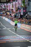 Canazei, Italy May 24, 2017: Pierre Rolland Cannondale-Drapac Pro Cycling Team  pass the finish line and win the stage. After a hard montain stage of Tour of Stock Photo