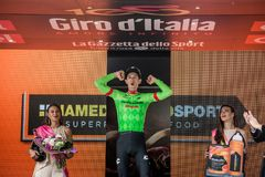 Canazei, Italy May 24, 2017: Pierre Rolland Cannondale-Drapac Pro Cycling Team,  on the podium. After winning a hard montain stage of Tour of Italy 2017 that Stock Image