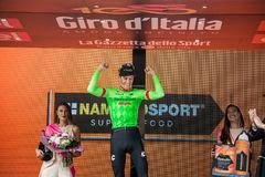 Canazei, Italy May 24, 2017: Pierre Rolland Cannondale-Drapac Pro Cycling Team,  on the podium. After winning a hard montain stage of Tour of Italy 2017 that Royalty Free Stock Image