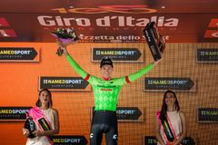 Canazei, Italy May 24, 2017: Pierre Rolland Cannondale-Drapac Pro Cycling Team,  on the podium. After winning a hard montain stage of Tour of Italy 2017 that Royalty Free Stock Photos