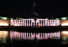 Enlighten festival in Canberra. Canberra, Australia - March 10, 2018. A projection on the Parliament House of Australia during the 2018 Enlighten festival in stock photography