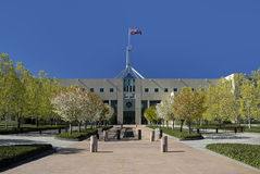 CANBERRA PARLIAMENT HOUSE. Parliament House in Australian capital city Canberra, waving flag Royalty Free Stock Images