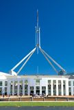 Canberra Parliament House. People standing in front of Canberra Parliament House, clear blue sky Stock Photo