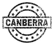 Scratched Textured CANBERRA Stamp Seal. CANBERRA stamp seal watermark with distress style. Designed with rectangle, circles and stars. Black vector rubber print royalty free illustration