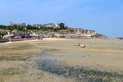 Cancale at low tide. Beautiful cityscape view of the skyline and beach at low tide of the city Cancale, France, in summer Stock Photography