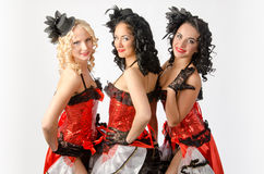 Cancan dancers. Three young girls dancing in studio a french cancan Royalty Free Stock Images