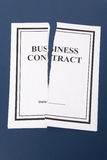 Cancel Business Contract. Torn paper royalty free stock photo