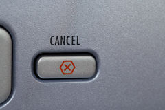 Cancel Button. Symbolized by a red X on a piece of electronics royalty free stock image