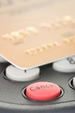 Cancel the transaction. Credit card on pin pad card reader out of focus with attention on red cancel button stock images