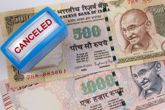 Canceled banknote concept. Mahatma Gandhi on Indian 500, 1000 rupee banknote canceled. stock image