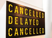 Canceled, delayed, canceled sign text letters words timetable. Canceled, delayed, canceled sign text letters words on the yellow vintage indicator similar to royalty free stock image