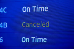 Canceled fllight status. Close up of airport status board with On Time and Canceled departures Stock Photo
