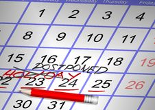 Canceled holiday. Days marked on a calendar as a holiday crossed and a word postponed written over it stock image
