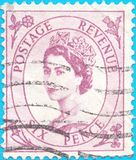 Canceled postage stamp, depicting Great Britain Tangier Queen ElizabethII 1952-54 Issu.  royalty free stock image