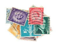 Canceled vintage postage stamps. A small group of canceled vintage postage stamps on a white background stock photography