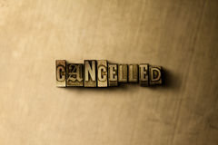 CANCELLED - close-up of grungy vintage typeset word on metal backdrop. Royalty free stock illustration.  Can be used for online banner ads and direct mail Royalty Free Stock Photo