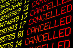 Cancelled flights on airport board stock image