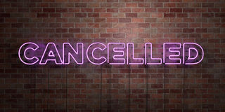 CANCELLED - fluorescent Neon tube Sign on brickwork - Front view - 3D rendered royalty free stock picture Stock Photos