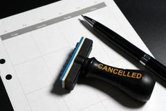 Cancelled planning, appointment, schedule, meeting concept. Business planning cancelled with blank calendar, pen and cancelled rub. Ber stamp on black background Royalty Free Stock Photo