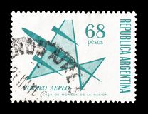 Cancelled postage stamp printed by Argentina. That shows Stylized airplane, circa 1965 stock images