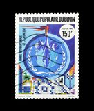 Cancelled postage stamp printed by Benin. That shows Mosaic of young holding the torch, circa 1986 royalty free stock image