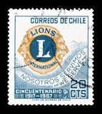 Cancelled postage stamp printed by Chile. That shows Lions emblem, circa 1967 royalty free stock photos