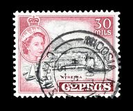 Cancelled postage stamp printed by Cyprus. That shows Kyrenia and portrait of queen Elizabeth, circa 1955 stock photos