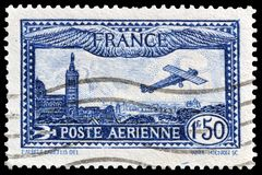 Cancelled postage stamp printed by France. That shows Plane over Marseilles, circa 1930 stock photos