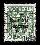 Cancelled postage stamp printed by Germany. That shows Coat of arms with overprint, circa 1948 stock photo