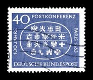 Cancelled postage stamp printed by Germany. That shows Commemoration of Post conference Paris, circa 1963 stock photography