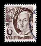 Cancelled postage stamp printed by Germany. That shows portrait of Holderlin stock photography