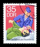 Cancelled postage stamp printed by Germany. That shows Fire department, circa 1977 stock photo