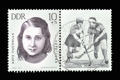 Cancelled postage stamp printed by Germany. That shows Cancelled postage stamp printed by German Democratic Republic, that shows German hockey player Kate royalty free stock image