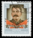 Cancelled postage stamp printed by Germany. That shows portrait of Stalin, circa 1954 stock images