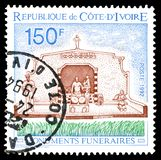 Ivory Coast on postage stamps. Cancelled postage stamp printed by Ivory Coast, that shows Funeral monuments, circa 1992 stock images