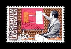 Postage stamp printed by Liechtenstein. Cancelled postage stamp printed by Liechtenstein, that shows Scientist, circa 1984 stock photography