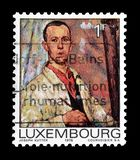 Cancelled postage stamp printed by Luxembourg. That shows portrait of a man, circa 1975 royalty free stock images