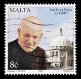 Cancelled postage stamp printed by Malta. That shows Saint Gorg Preca, circa 2007 stock photos