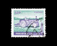 Cancelled postage stamp printed by Pakistan. That shows Tractor stock images