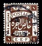 Cancelled postage stamp printed by Palestine. That shows coat of arms stock photography