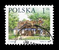 Cancelled postage stamp printed by Poland. That shows Country house, circa 1999 stock photography