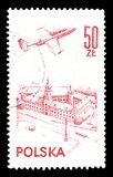 Cancelled postage stamp printed by Poland. That shows Plane over Warsaw, circa 1978 royalty free stock image