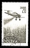 Cancelled postage stamp printed by Poland. That shows Plane putting out fire, circa 1977 stock images