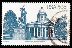 Cancelled postage stamp printed by South Africa. That shows Raadsaal Bloemfontein, circa 1982 royalty free stock photos