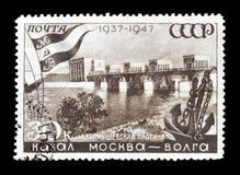 Cancelled postage stamp printed by Soviet Union. That shows Karamyshevsky Dam, circa 1947 stock image