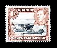 Cancelled postage stamp printed by Uganda, Kenya and Tanganyika. That shows Lake Naivasha and king George, circa 1938 stock photos