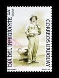 Cancelled postage stamp printed by Uruguay. That promotes Immigrants day royalty free stock images