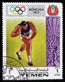 Cancelled postage stamp printed by Yemen. That shows Shot put, circa 1972 stock photos