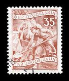 Postage stamp printed by Yugoslavia. Cancelled postage stamp printed by Yugoslavia, that shows Construction industry, circa 1950 royalty free stock image